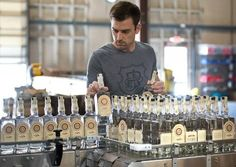 J. Rieger co-founder Andy Rieger looks over some of the first bottles of the company's Midwestern Dry Gin, a London Dry-style spirit that the company began bottling last week.