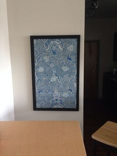 DIY Covered bulletin board with wallpaper to hide electrical box in kitchen