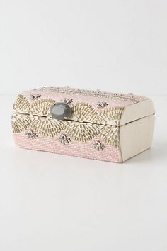 anthropologie jewelry box - could be an easy diy using beads & a plain box