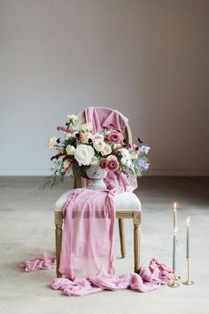 Mauve flower arrangement inspiration. Carnations, peonies, gerrondo daisies, sweet pea, chocolate cosmos, and amaranthus in a stone vase. Gorgeous blush, mauve, and grey wedding reception colors.