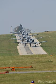 This is a photo of multiple CANS of WOOP-ASS awaiting takeoff - The USAF A-10 Warthog!!!