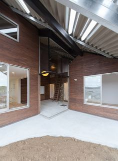 Japanese house sheltered beneath a large asymmetric roof.