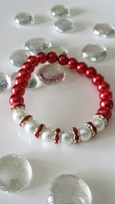 Handmade stretchy bracelets made with glass Pearl beads, rhinestones These bracelets come In white and red beads. You can choose the middle part color you want from the list. If you choose Red(middle part), the rest of the bracelet will come in Pearl If you choose Pearl(middle
