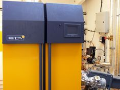 Wood pellet boiler Solar Thermal Panels, Solar Panels, Wood Pellets, Solar Installation, Heat Pump, Energy Technology, Boiler, Heating Systems, Locker Storage