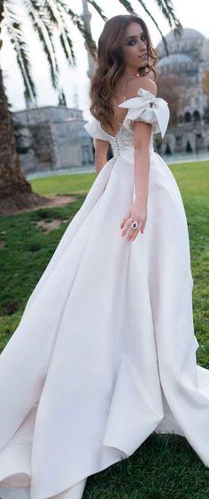 Off the shoulder plunging neckline sheath wedding dress detachable skirt long train #wedding #weddingdress #weddinggown #bridedress #bridalgown #weddingdresses
