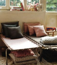 Vintage camping beds make for a cool chill out space