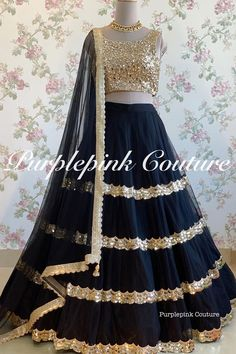 This most preferred Black Gold Hand Embroidered Net Lehenga Choli can uplift your style and make you stand out by it's unique style and design. Latest Lehnga Designs, Lehenga Designs Simple, Wedding Lehenga Designs, Indian Fashion Dresses, Indian Bridal Outfits, Indian Gowns Dresses, Indian Designer Outfits, Bridal Dresses, Fashion Outfits