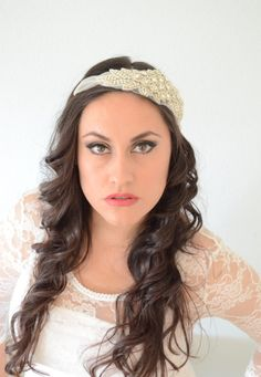 This headpiece is made from illusion tulle and Tons of Crystal Rhinestones with some beading. Attached with metal combs. A HIGH Sparkle Headpiece.$86.00