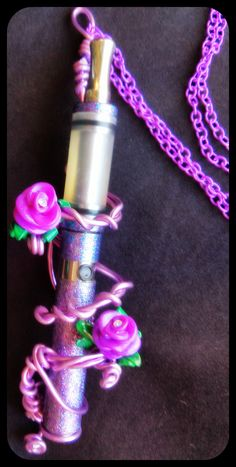 Handmade twisted purple wire with handmade berry purple roses with rhinestone in center Ego size personal vaporizer lanyard/holder. Herbal Vaporizer, Vaporizer Pen, Best Vaporizer, Vape Pen For Sale, Wire Crafts, Purple Roses, Girls Be Like, How To Run Longer, Herbalism