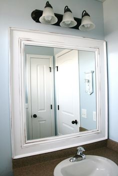 Framed Mirror tutorial - turn a typical, boring bathroom mirror into a beautiful framed one