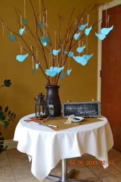 Welcome table:  Everyone write a note or wish then tie it to the limbs.  Use real tree branches, or artificial.  Saw some pussy willow and cherry blossom branches in hobby lobby.