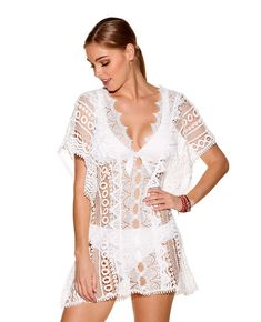 f30c38ea46f3 Cut from sheer dimensional white lace, this luxe poncho-style swim cover-up  is ready to pack for your next tropical desination.