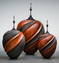 "Mahogany Spiral Lidded Vessels by Avelino Samuel from Craft Supplies USA --- These were created using a variety of carving, texturing and finishing techniques to create a perfect blend of color, texture and contrast that emphasize the natural beauty of the wood. The pieces are approximately 14"" to 18"" tall. #woodturning #woodturnerscatalog"