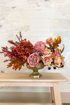 Create a stunning floral centerpiece with artificial flowers and dried hydrangeas. This fall centerpiece is the perfect finishing touch for your Thanksgiving tablescape or for your fall wedding. Shop this look by @lifesfrostings at Afloral.com.