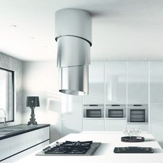 "A piece of art for the kitchen, Pareo from Faber is a retractable range hood with a distinctive look. The island hood starts on the ceiling at 16"" tall and..."