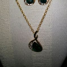 Gold emerald green rhinestone necklace earring set This is a green rhinestone necklace and earring set. The necklace is 18 inches long.I can add links if you need.The earrings are 2 inches long.Check out my other necklace sets I am listing. Pamela May Collection Jewelry Necklaces