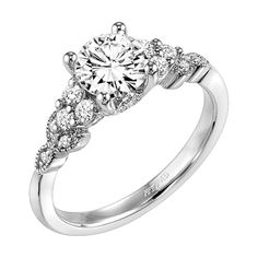 <3 The Adeline ring: Diamond engagement ring with round center stone and vine motif diamond enhanced shank.