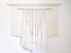 Large woven wall art Pure dreams will become an elegant highlight of your sweet home or work studio! Woven in ivory color from natural wool.  Wall art is also a perfect gift for your loved ones!  Size: 32 x 32 (with fringe) / 80 x 80 cm. Ships ready to hang on hand-painted wooden dowel (37