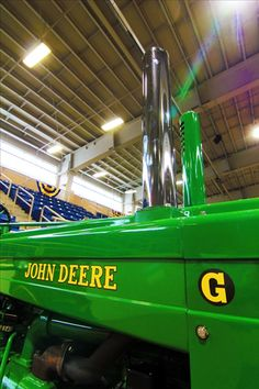 Twin spires of the exhaust and air intake on a John Deere G rise toward the ceiling of the equine arena during the antique tractor show Wednesday at the 2012 Pennsylvania Farm Show in Harrisburg.