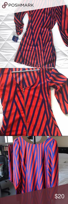 Red and navy blue striped dress Striped dress, never wore, received as gift and ended up being too big for me. Cute back zipper detail! I'm 5'1 and it falls at my knees for an idea of length! Brand listed for exposure, no brand tag.  Offers encouraged! ☺️ 15% off on all bundles 2 or more 💰 No trades ✖️ Help me save up for my next trip ✈️💕 ASOS Dresses