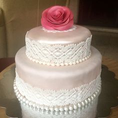 A two tier lace cake - the lace is made with Sweet Lace Express but the rose is just plain and simple fondant