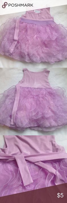 Lavender Bonnie Jean dress sz 2t Lavender formal dress sz 2t. Top fabric has a beautiful shine to it! There are a few small spots on the front as shown in the pic. Not super noticeable. Bonnie Jean Dresses Formal