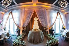 Traditional Ivory Wedding Reception with Five Tier Ivory and Gold Round Wedding Cake at Downtown St. Petersburg Wedding Venue The Birchwood | Photography by Limelight Photography | Custom Lace Linens by Over The Top Linens