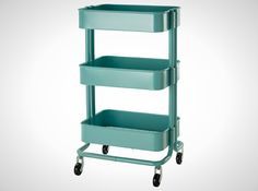 This turquoise kitchen cart is just what you need to keep things organized.