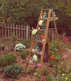 old wooden ladder in the garden - mason jars, can let plants climb or trail - i only wish i had more ladders! #Garden #UpcycleLadder #RepurposeLadder - pb†å