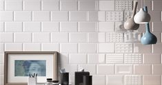 White subway tiles are a classic choice for any design style. But have you considered shaking up your design with a handcrafted look or beveled tiles? Check out our idea book for subway tile inspiration! Tile Layout Patterns, Brick Patterns, White Subway Tiles, Ceramic Subway Tile, 3d Tiles, Wall Tiles, Condo Kitchen Remodel, Wood Plank Tile, Kitchen And Bath Design