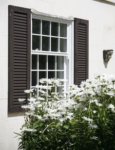 Sliding sash windows with shutters supplied by PDS offering high quality timber doors, timber windows and bespoke joinery. www.pdsdoorsets.co.uk