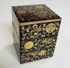 Mini Jubako Japanese Laquered Box by NA. $29.95. Excellent gift! Boxed, made in Japan. This is also known as a mini Jubako. Beautifully decorated in gold designs on black laquer. 3 layers and a lid, 3 1/2 inches wide and 4 1/2 inches tall. Nice for keeping jewelry or secrets!. Beautiful 3 layer laquer Japanese box 3 1/2 inches square and 4 1/2 inches high. This mini jubako is black laquered inside perfect for display and or keeping jewelry, candy or special items!