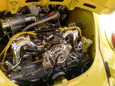 Someone please tell me what engine this is and how they shoehorned it into that Bug. I miss having classic Beetles :(