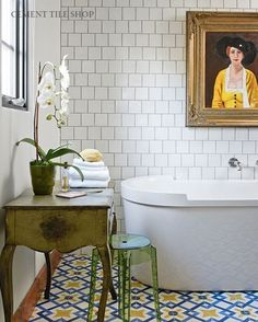 White cropped subway wall tile and Moroccan style floor tile bathroom.