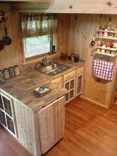 A 240 square foot tiny house with downstairs office, upstairs sleeping loft and living area. Here's the adorable kitchen. | Tiny Homes