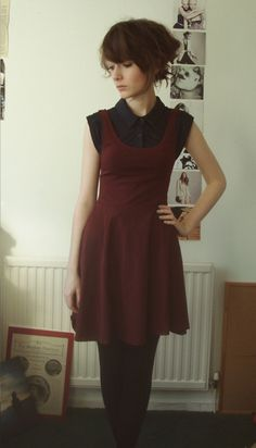 Retro twee: maroon jumper over a black sleeveless collared blouse