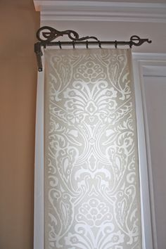 for the door windows Metal scrollwork drapery rods hold a length of ivory damask. Sun shines through the beautiful, sheer, floral lace on the windows. Pretty idea for sidelights. Sidelight Curtains, Sidelight Windows, Front Doors With Windows, Curtains With Blinds, Panel Curtains, White Curtains, Valances, Front Door Curtains, Beaded Curtains