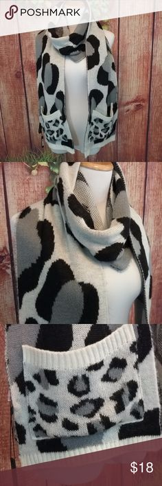 🌼🌻EUC IVanka Trump Scarf🌼🌻 EUC animal print, knitted scarf with pockets! It still has the tag attached but not price tag, so I won't post nwt. Also the car label has come partially unsewn. Otherwise this scarf is in great condition.  Soft knit pockets-need I say anything more 100% Acrylic Ivanka Trump Accessories Scarves & Wraps