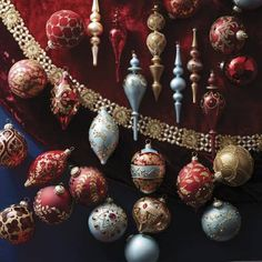 View Full Collection     Our exclusive Parisian Christmas 60-pc. Ornament Collection adds a certain je ne sais quoi to your holiday tree. In traditional burgundy and gold,     these curated glass ornaments are painted or embellished by hand with sequins, crystals, beads and faux pearls. The mix of sizes and shapes creates an     acquired, heirloom look.                    60-piece set; view all of the ornaments in this collection                     Matte, metallic and crackled finishes…