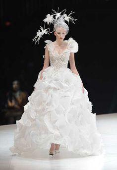 A model wears a wedding dress by Japanese fashion designer Yumi Katsura during the 2013 Yumi Katsura Grand Collection in Tokyo on February 20, 2013.