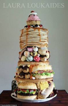 Wow: Baker Laura Loukaides has created an incredible cake that looks like a pile of junk food (above)