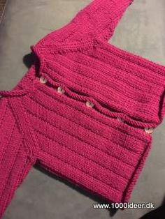 A small cardigan wilh rolling borders, age 0-3 month