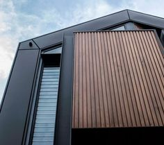 House Cladding Ideas: 8 Types Of External Cladding - External cladding for houses provide protection from the elements and aesthetic qualities. We explore 8 external house cladding ideas and materials. House Cladding, Metal Cladding, Wall Cladding, Fence Landscaping, Backyard Fences, Low Fence, Front Fence, Farm Fence, Concrete Fence