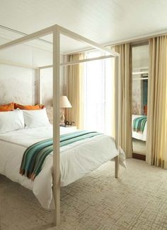 accents of orange and teal add playful energy to an otherwise neutral and sophisticated bedroom