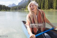 Stock Photo : Mature woman enjoying canoe ride