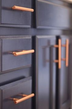 Gray Bathroom Navy Cabinets Copper Hardware Pulls