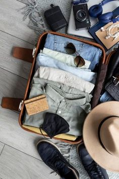 Download this Composition of clothes and accessories in a suitcase Free Photo, and discover more than 11 Million Professional Stock Photos on Freepik. #freepik #photo #travel #trip #suitcase