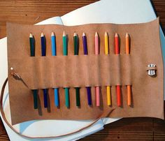 Such a beautiful gift that's handmade in the United States. When you roll it up, you can see the rainbow of colors on the outside. (I'm putting this on my wish list.) :: Charles Pencil and Pencil Sharpener Case by This is Ground
