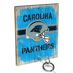 Team Toss for Carolina Panthers fans from Team ProMark is a fun and addictive game that's easy to learn but difficult to master. Toss the ring on the eye hook and score a point. The vintage team board designs make a great addition to any fan cave or game room wall. Play individually or pair up for teams while the gang is over watching the game.
