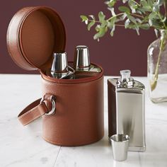 Monogrammed 6-Piece Bar Set | With a sleek leather silhouette and secure carrying handle, this durable bar set includes three flasks and three small cups.